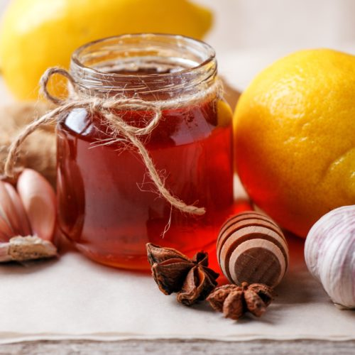 Homemade antimicrobial therapy. Ingredients for healthy tea with herbs, honey, ginger, garlic and lemon, seasonal traditional flu remedy drink